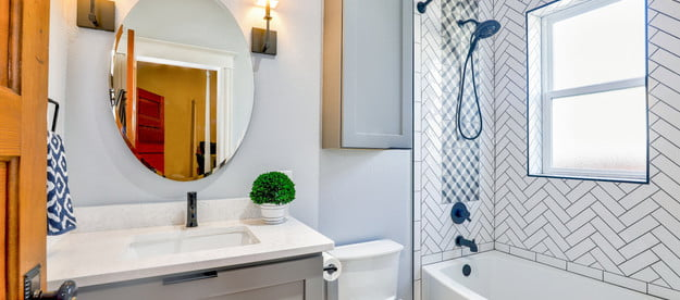 Bathroom with sconce lights