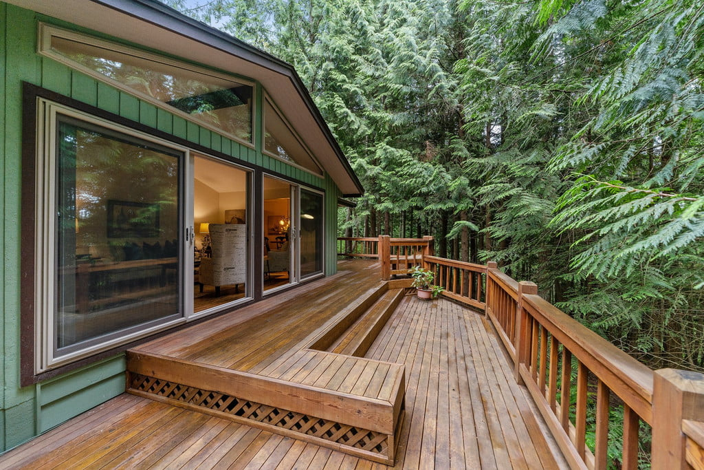 deck with railing overlooking woods