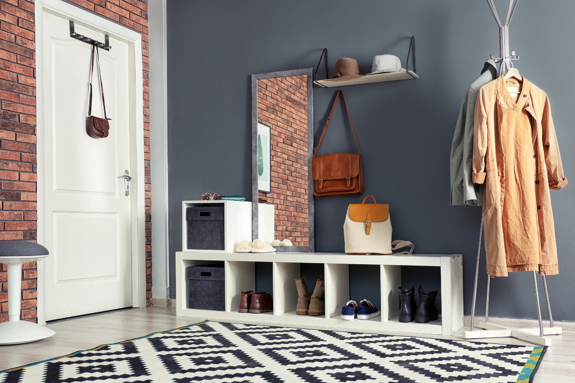 entryway with geometric rug