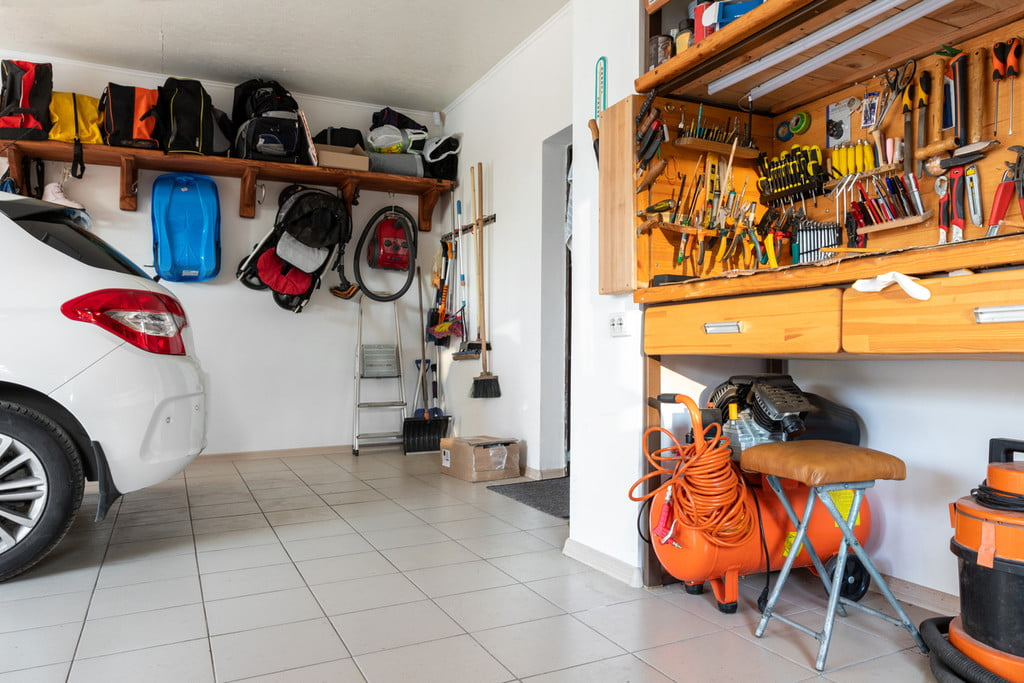 garage interior with car and tool bench