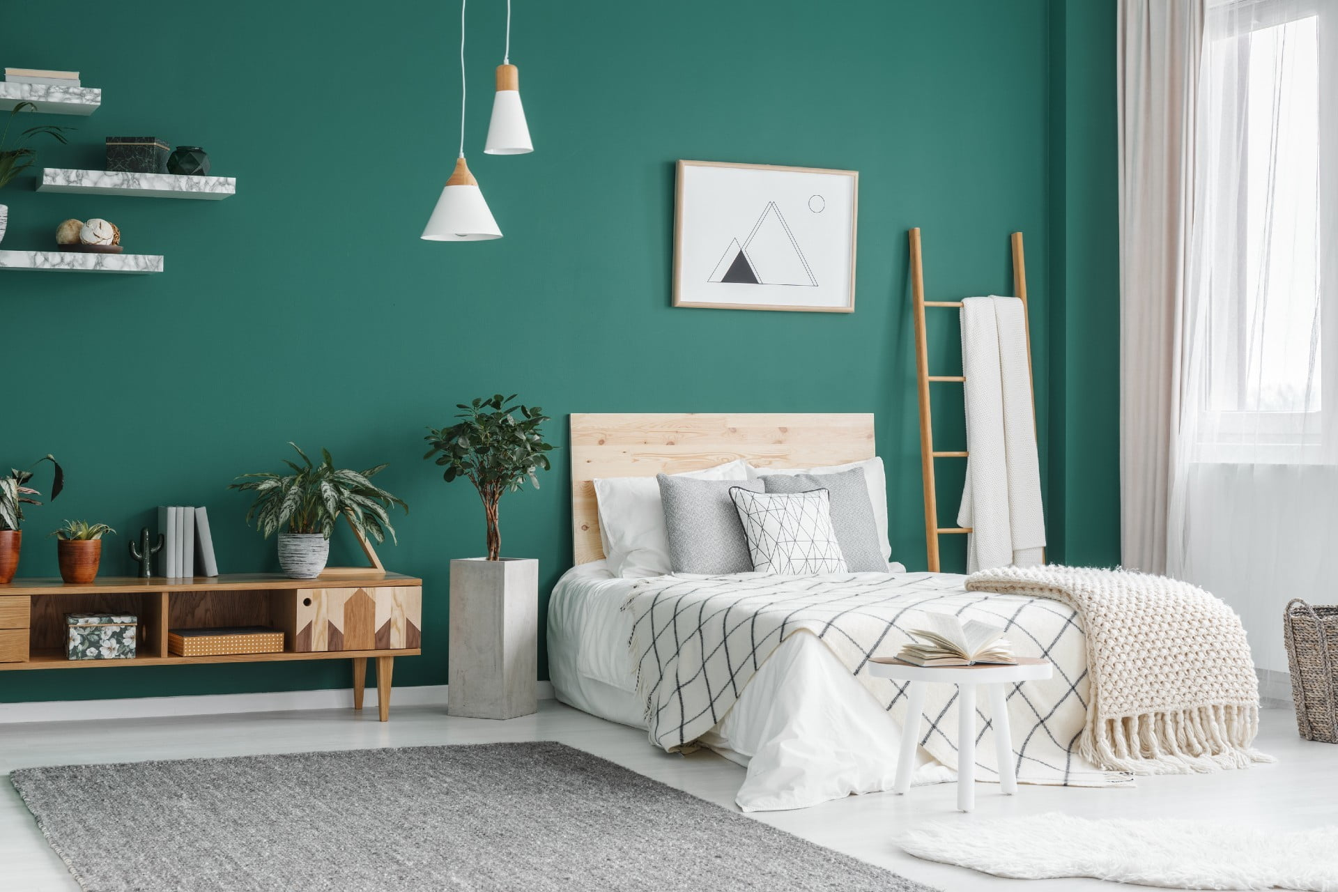 green bedroom with headboard