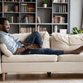 man lounging on couch