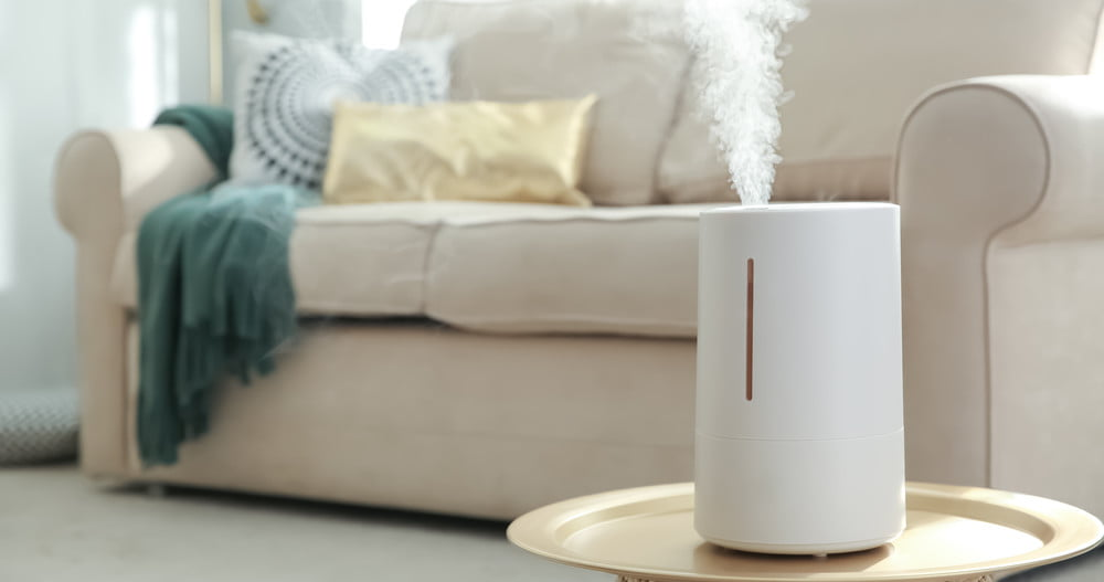 humidifier on accent table in bright living room