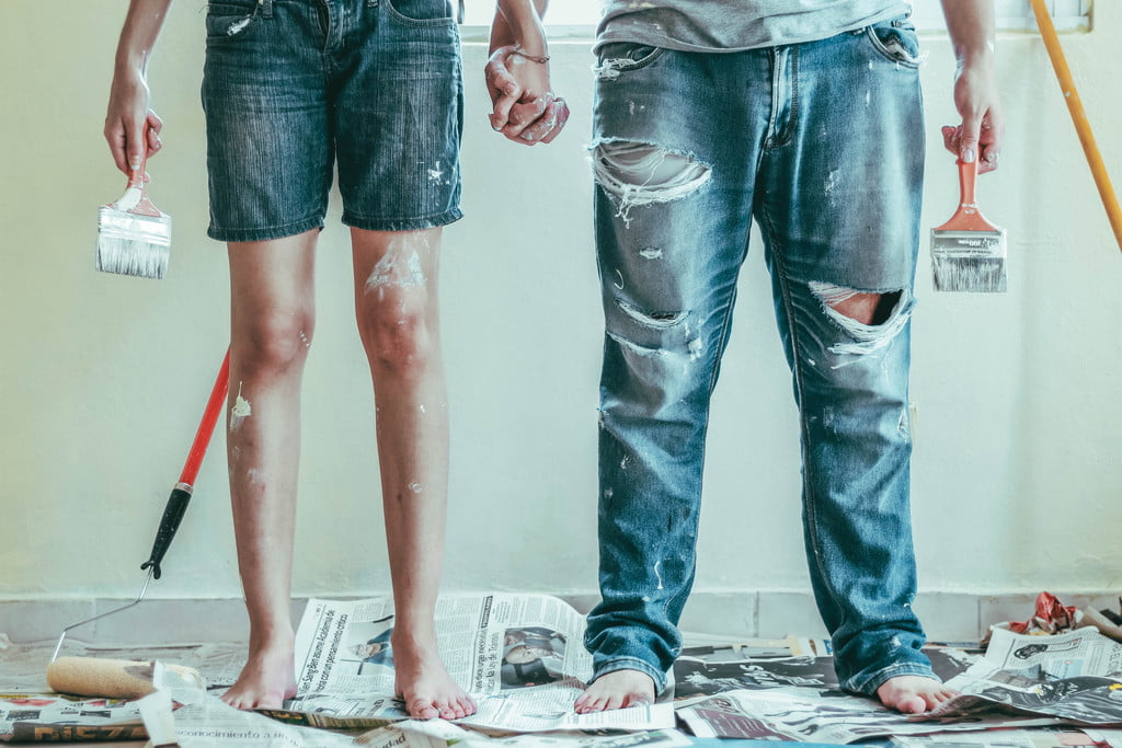 two people with paint on clothing