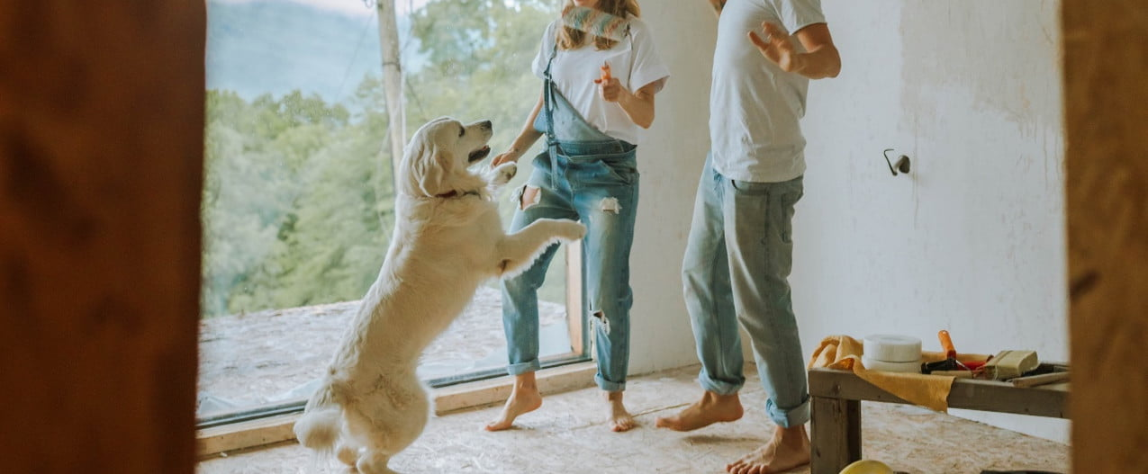 couple painting with dog