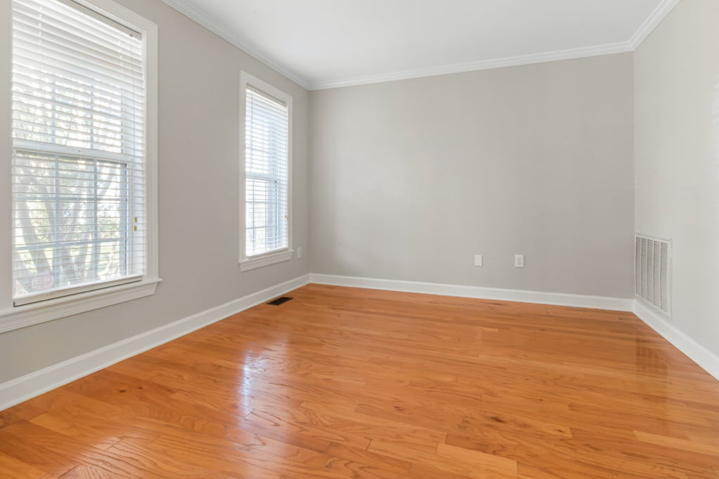 neutral room with wood floor