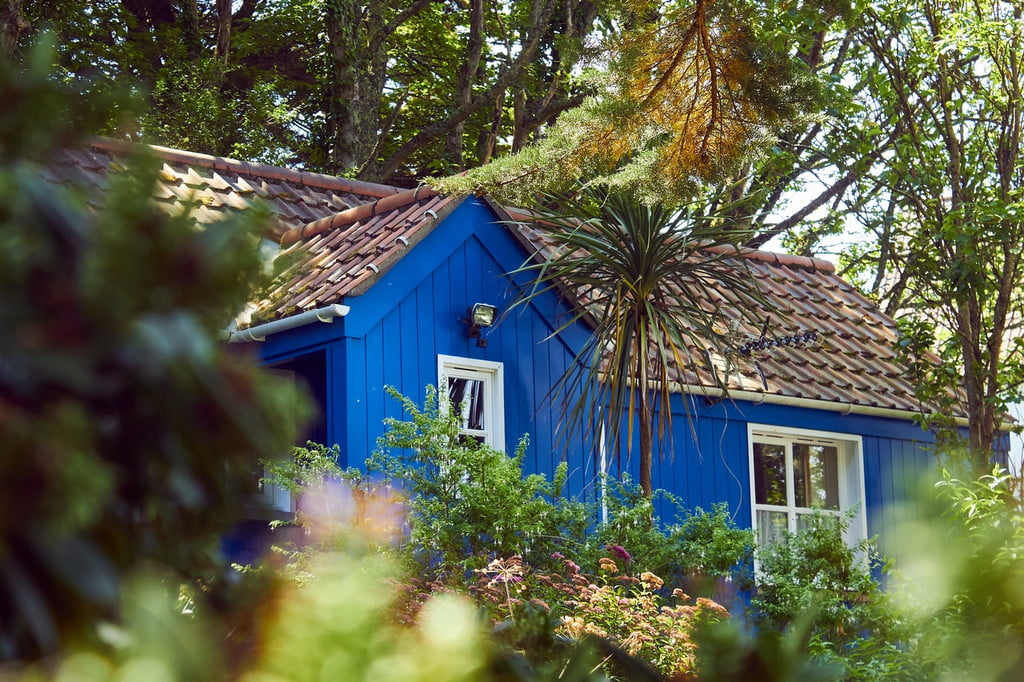 House with blue wooden siding