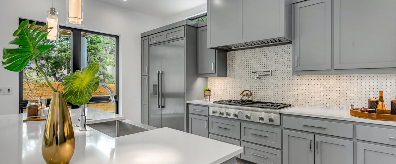 gray cabinets with wood floor