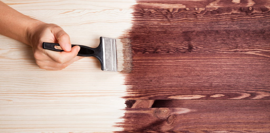 stain being painted on a table