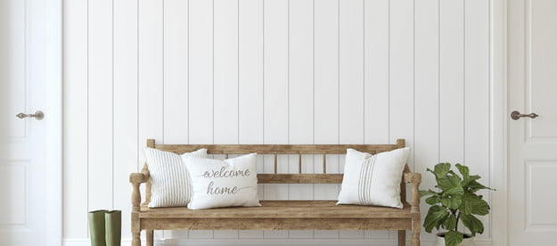 white painted wood paneling on wall
