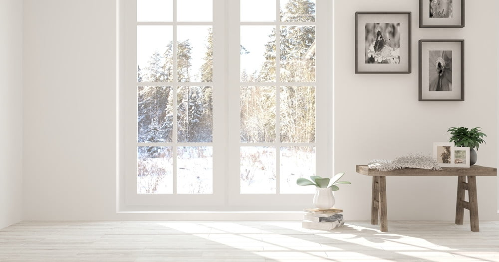 Winter outside through french doors in white living room