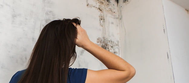 Woman frustrated by bathroom mold