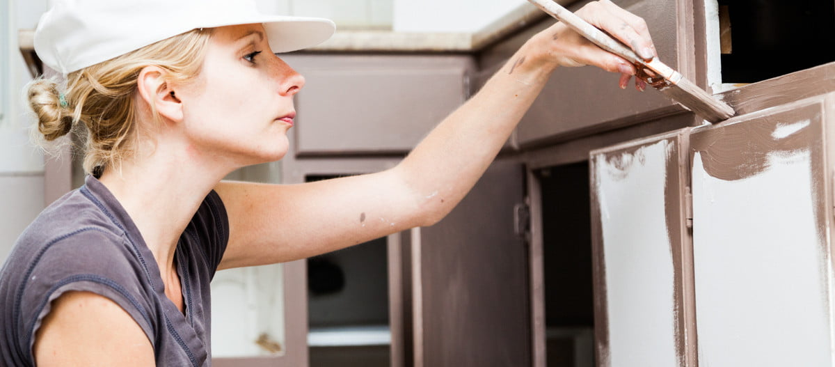 affordable kitchen cabinets replace woman painting