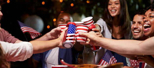 Group of friends toasting at a Fourth of July party