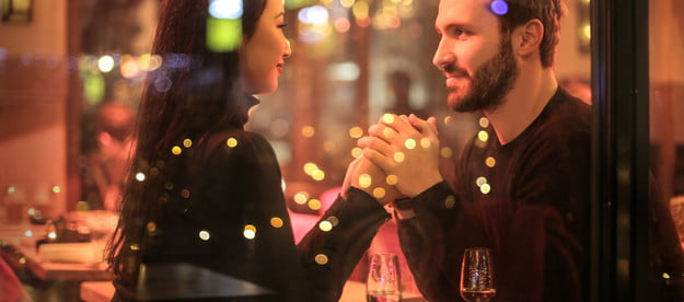 couple holding hands on romantic date