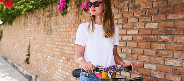 Woman in a t-shirt on a bicycle