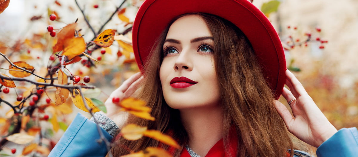 A woman in fall fashion and makeup.