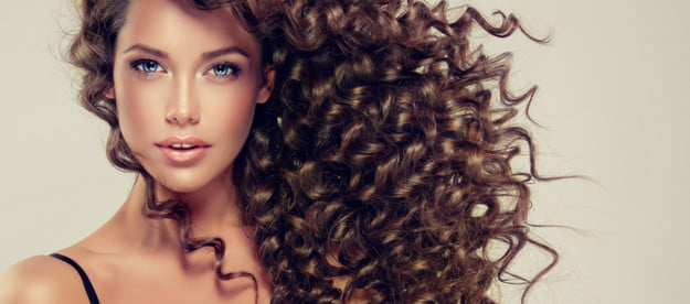 A woman with beautiful curly hair.