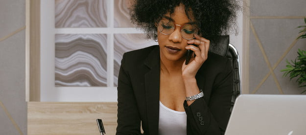Woman on the phone while writing