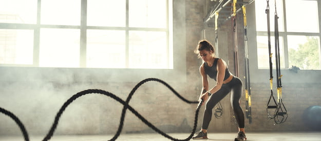 crossfit workout new year woman ropes gym jpg