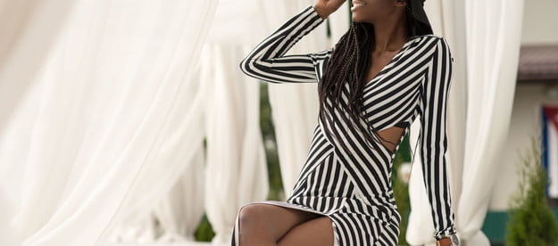 Woman wearing a striped dress and neutral accessories