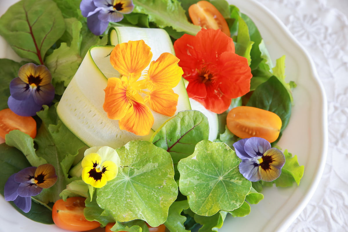 salad with nasturtium and pansy flowers