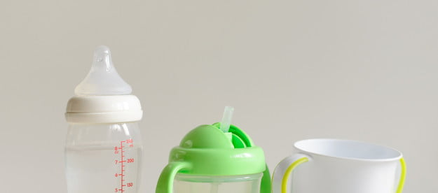 A baby bottle, sippy cup, and cup