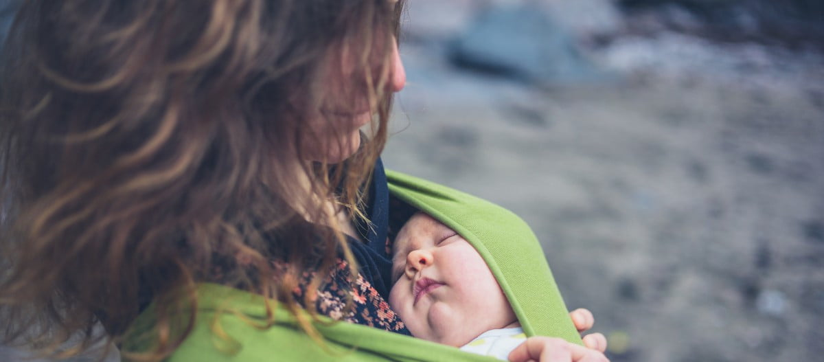 Mom with child in a baby sling
