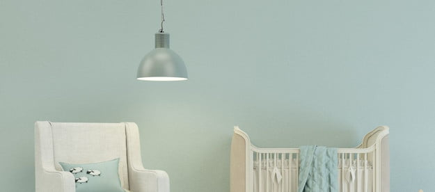 A chair and dresser In a nursery