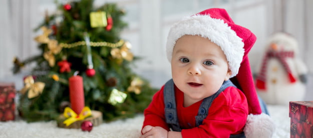 baby in front of tree