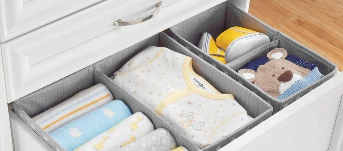 Drawer full of baby clothes
