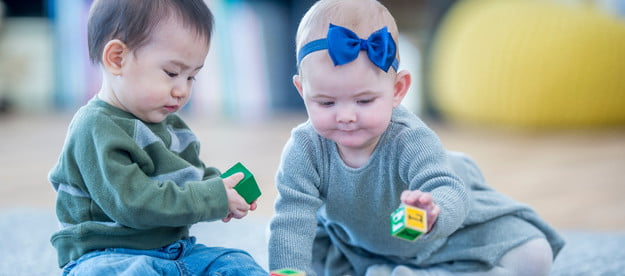 Boy and girl babies at day care
