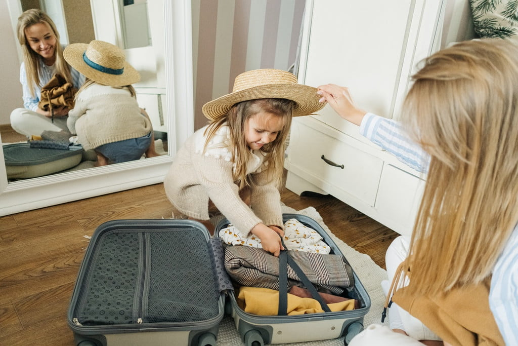 girl and mom packing clothing