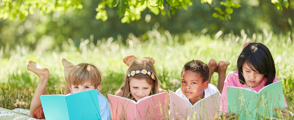Kids reading outside on a summer day