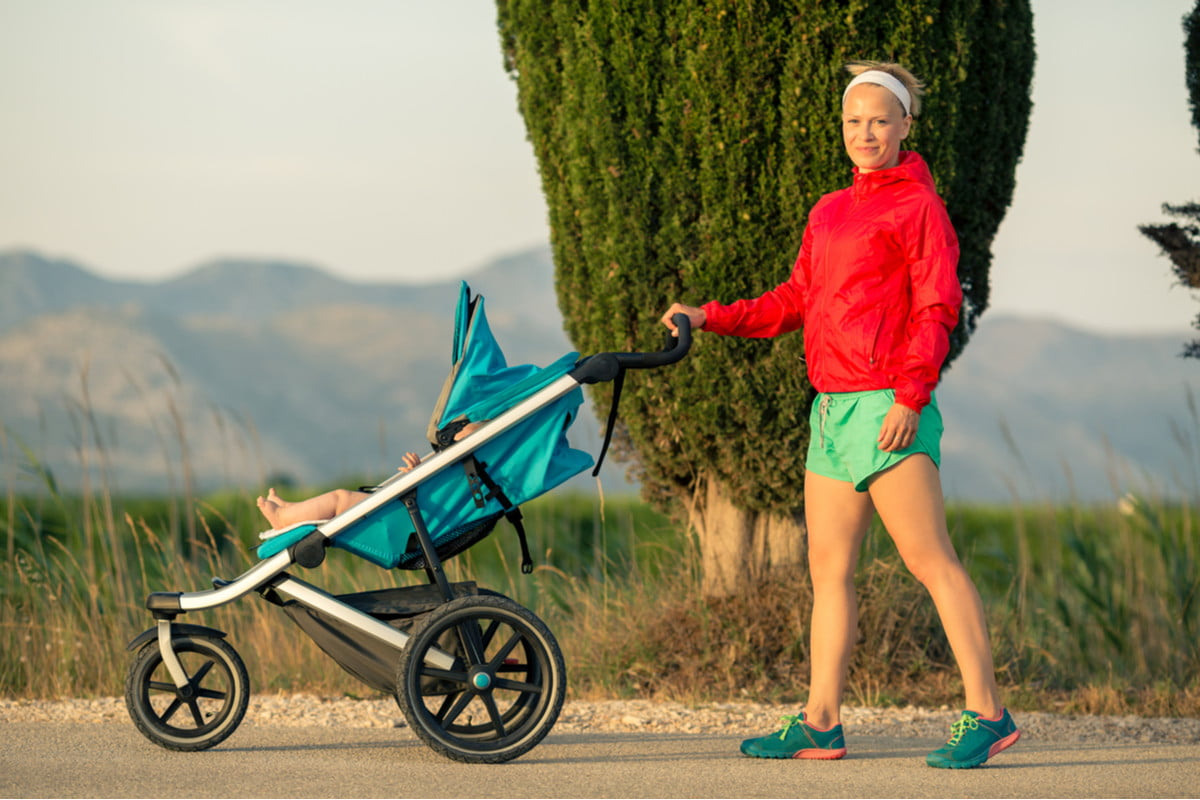 A woman, baby and running stroller