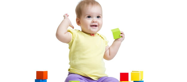 Baby playing with multicolored blocks