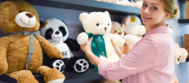 Woman picking out a stuffed toy for a gift