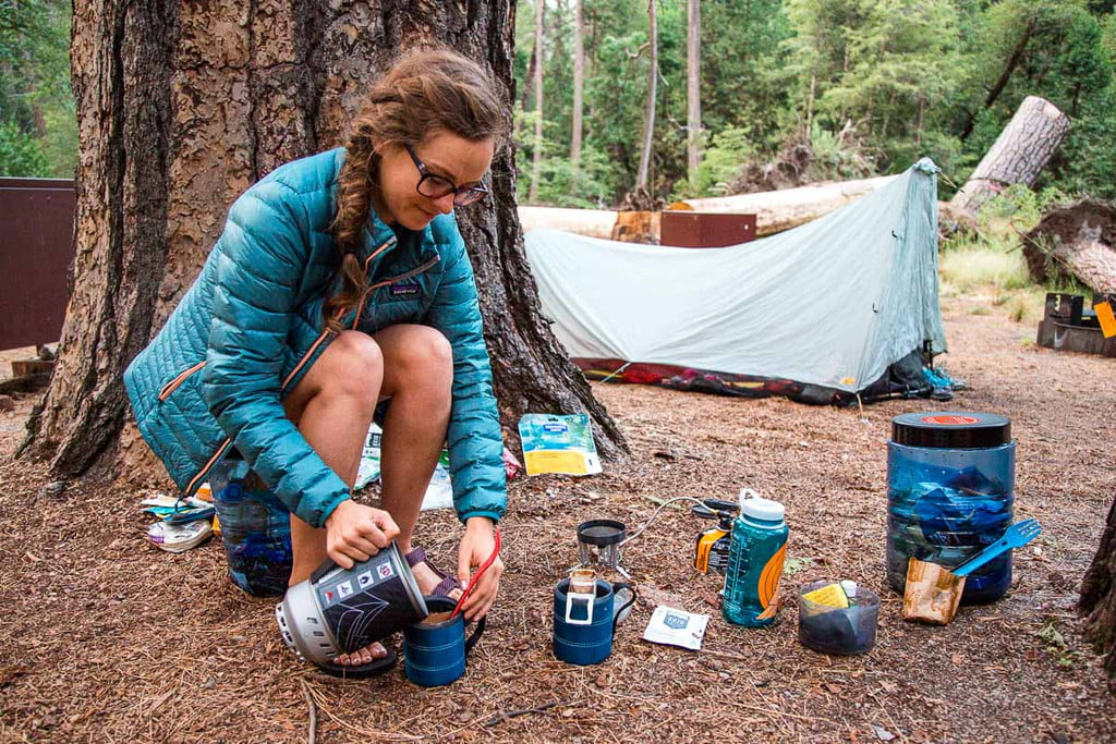 woman preparing backpacking lunch