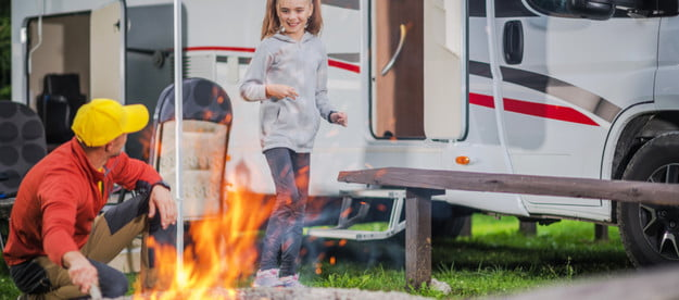 camper man and girl with campfire