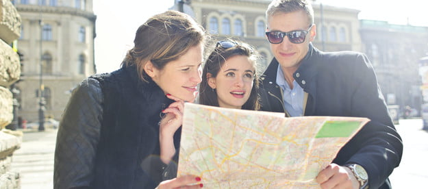 People Reading Map Together