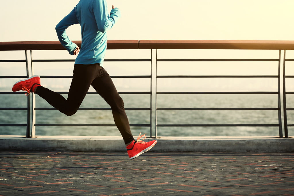 Woman running with bright shoes
