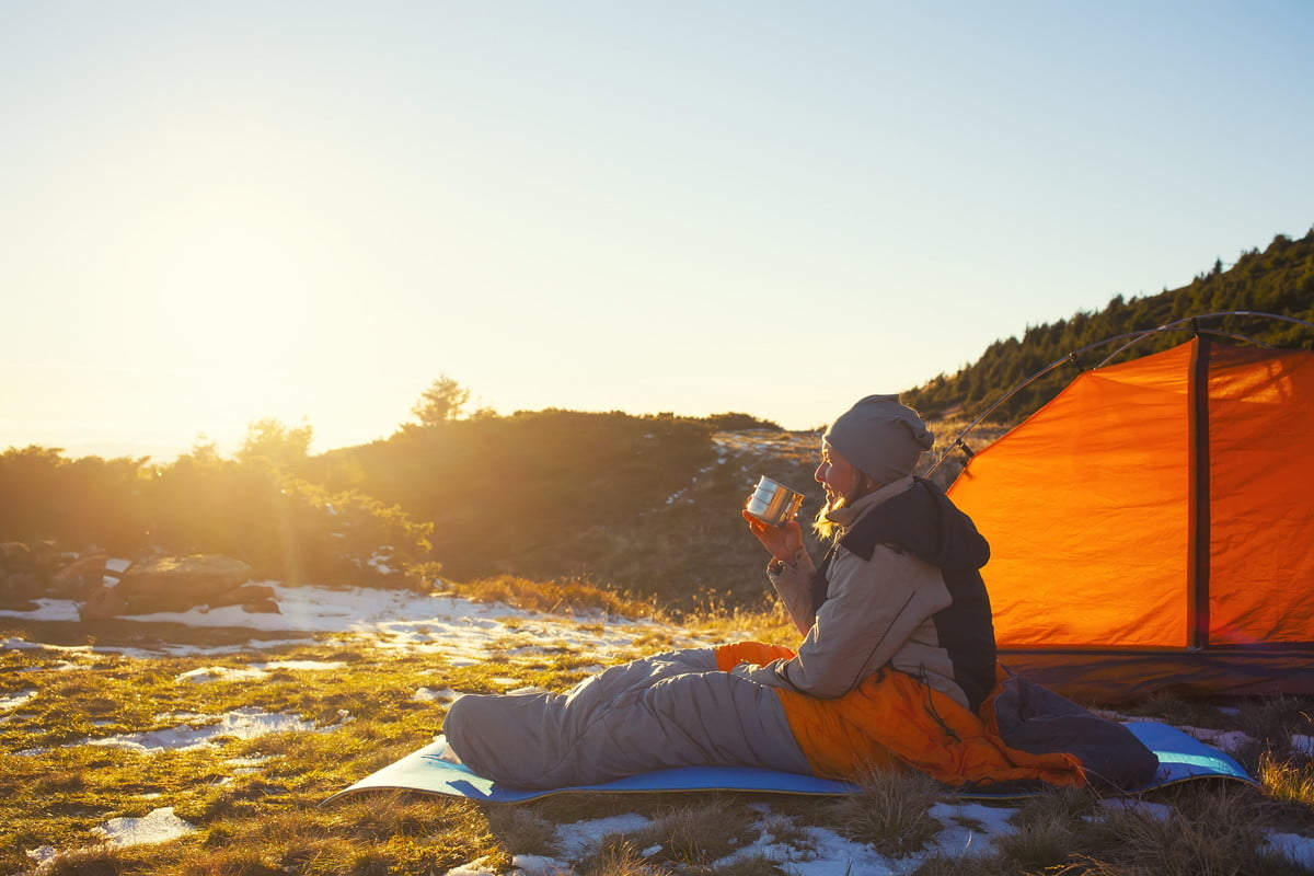 A woman goes camping in the cold