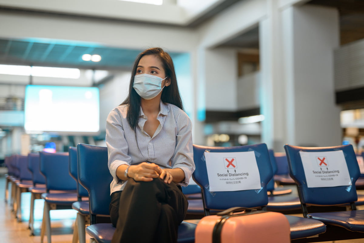 A woman with a mask at the airport