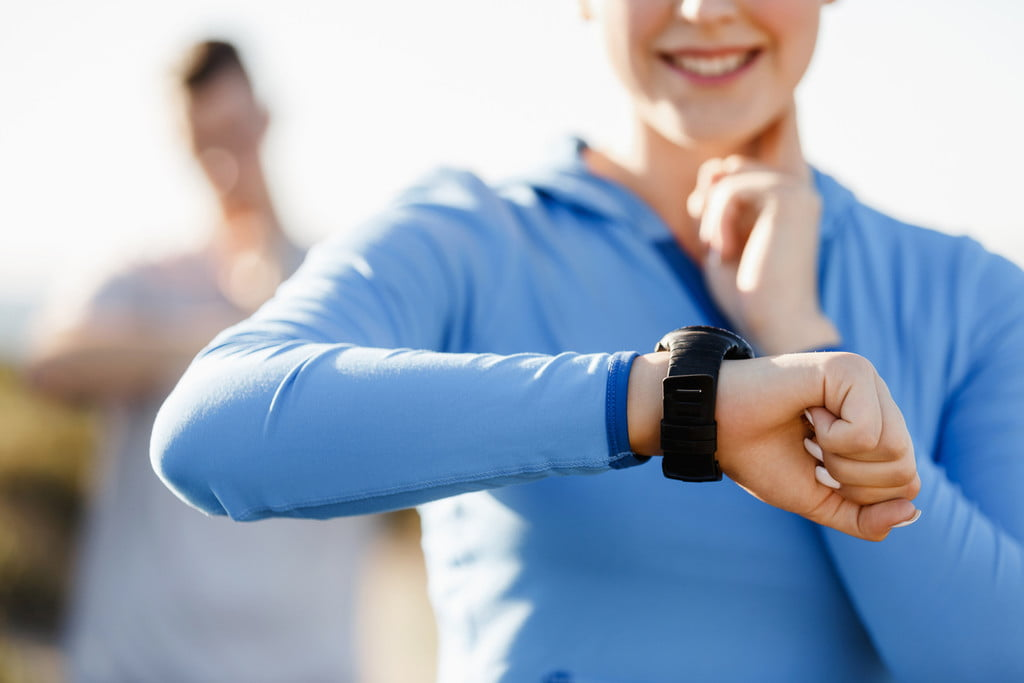 A woman checks her heart rate