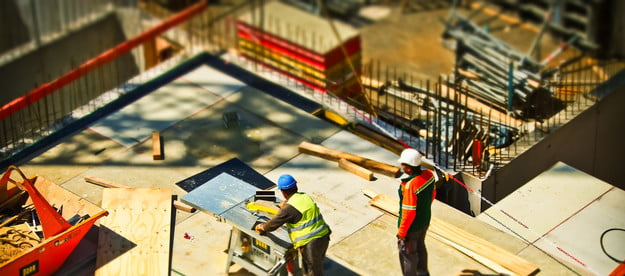Two men working on construction site