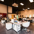 Open office space with desks and chairs