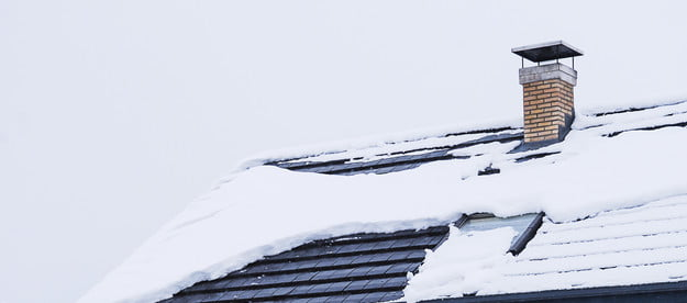 White snow covering a rooftop