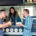 Two people at a food truck